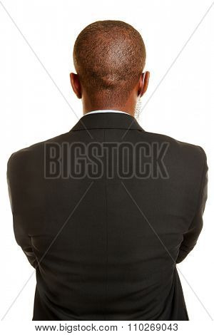 Bodyguard from behind in a suit with headset in ear