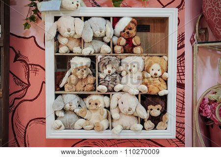 Group Of Soft Stuffed Toys On  Shelf