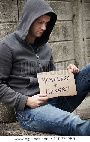 Homeless Young Man Begging On The Street