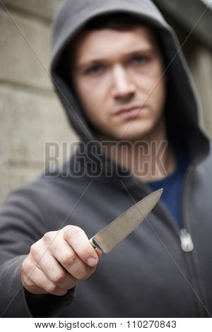 Threatening Looking Man Holding Knife