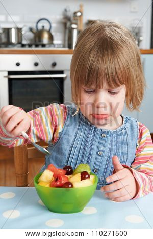 Fussy Child Rejecting Delicious Fruit Salad Pudding
