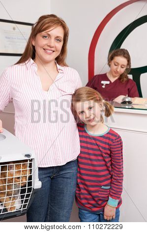Mother And Daughter Taking Cat To Vet