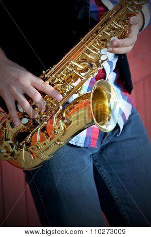 Saxophonist plays jazz, close up