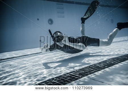 Safety Staff Member Having Fun Underwater Between Two Performances.