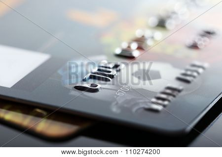 Credit cards on black background, close up