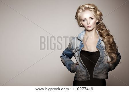 Model with long braided hair. Waves Curls Braid Hairstyle. Hair Salon. Updo. Fashion shiny hair. Woman with healthy hair, girl with luxurious haircut. Hair loss, braiding hair volume. jeans, denim