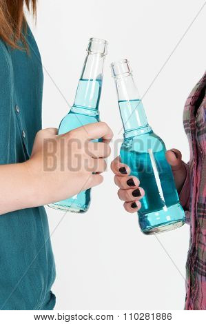 Studio Shot Of Two Teenage Girls Drinking Alcohol