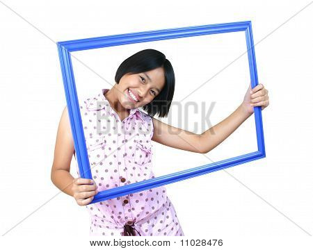 Portrait of girl posting with a frame