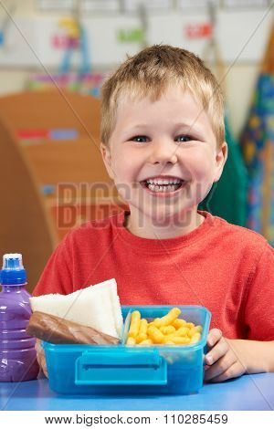 Elementary School Pupil With Unhealthy Lunch Box