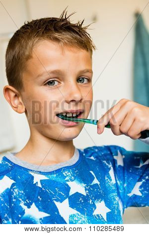 Young Boy Brushing His Teeth With Toothbrush