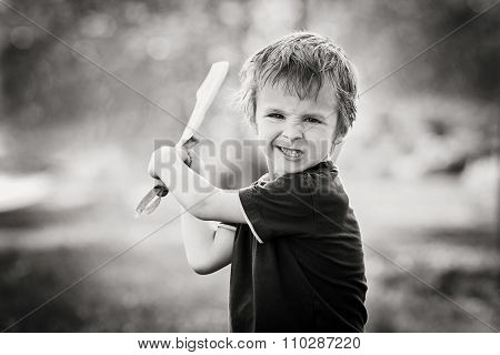 Angry Little Boy, Holding Sword, Glaring With A Mad Face At The Camera