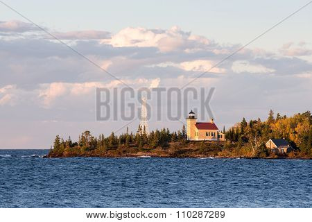 Lighthouse And Gathering Clouds In Evening Light