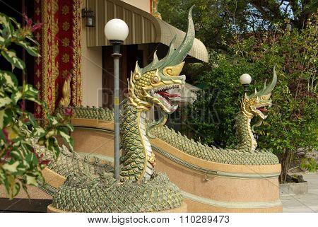 Krabi, Thailand - January, 2014: Dragon Sculpture On The Territory Of The Temple Wat Phokha Juthamat