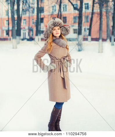 Beautiful Woman Wearing A Coat Jacket And Hat Over Snow In Winter Park