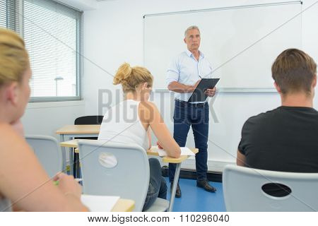 Teacher stood before class