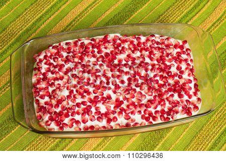 Naked cake with pomegranates