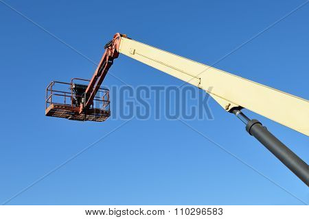 aerial platform against a blue sky