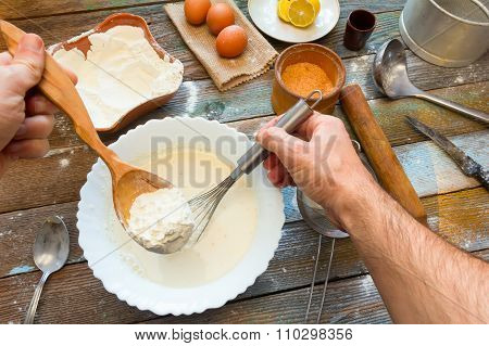 the man knead the batter