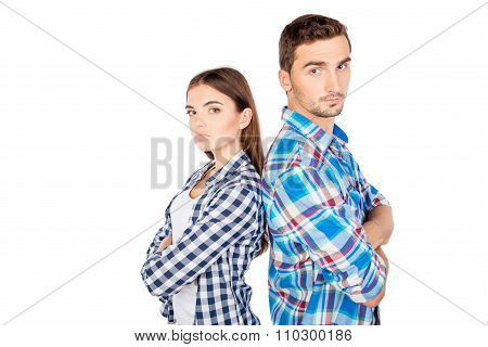 Young Disconnected Couple Standing Back To Back