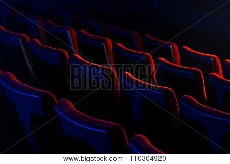 Young Loving Couple Kissing At The Cinema