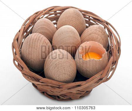 Wooden egs in wicker basket