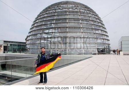 Man waving german flag