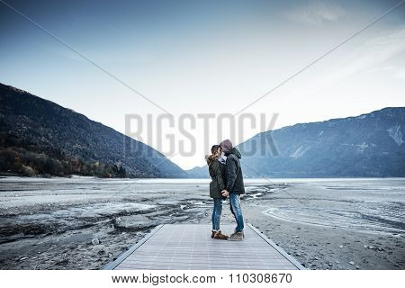 Romantic Young Couple On A Pier