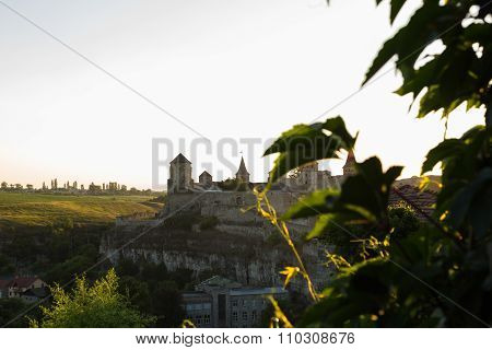 Beautiful landscape at sunset. View of the medieval fortress in the evening