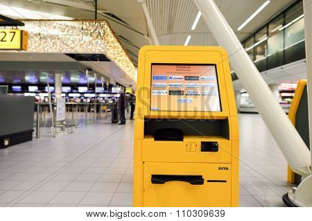 AMSTERDAM, NETHERLANDS - NOVEMBER 17, 2015: self check-in kiosk in Amsterdam Airport Schiphol. Amsterdam Airport Schiphol is the main international airport of the Netherlands.