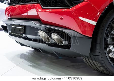 Car Exterior : Closeup Of Red Sport Car With Dual Exhaust Pipe