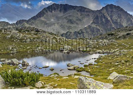 Small mountain lake and Kamenitsa peak, Pirin Mountain,