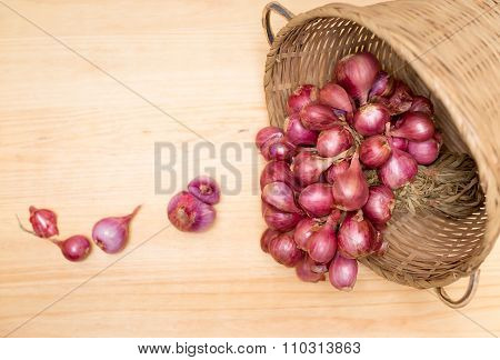 Red Onion Or Shallots In Wooden Basket