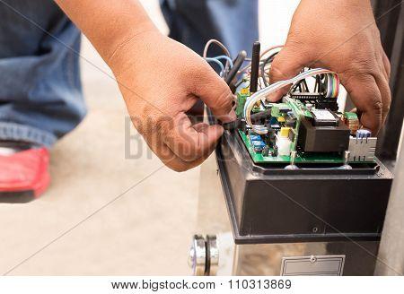 Man Repairing Electronic Control System
