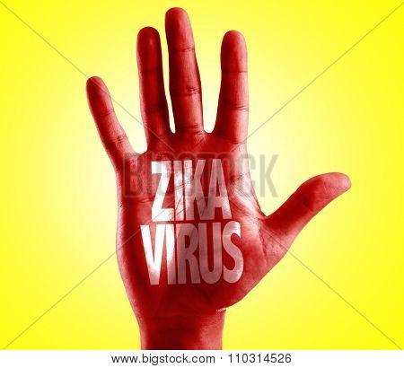 Zika Virus written on hand with yellow background