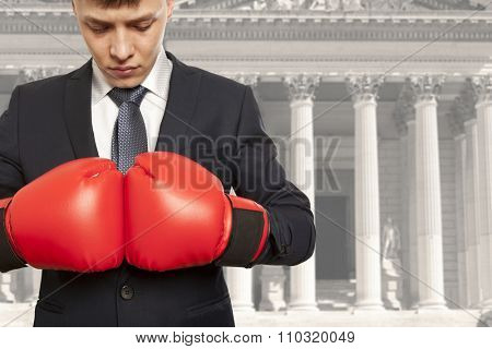 Legal concept. The lawyer in red boxing gloves