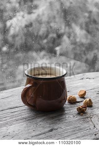 Tea With Milk And Biscuits On A Light Wooden Surface Against Window