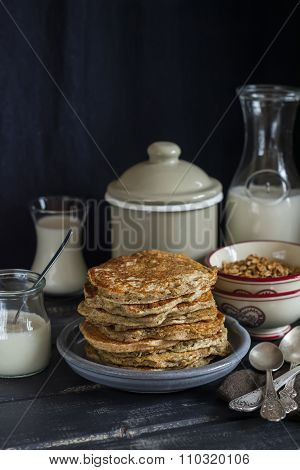 Healthy Breakfast Or Snack - Whole Grain Pumpkin Pancake, On A Dark Wooden Table