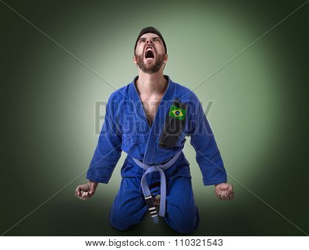 Brazilian judoka fighter on green background
