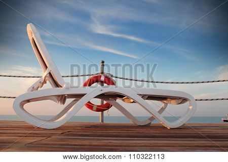 Sunbed On A Deserted Pier At Sea