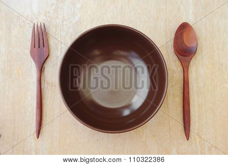 Brown Bowl With Fork And Spoon