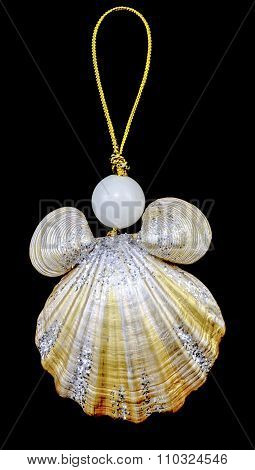 Christmas Toy Key Chain From Seashells And Pearls With Gold Rope Isolated On Black