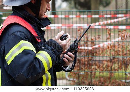 German smoke jumper calls with a walkie talkie