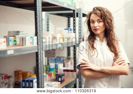 Pharmacist Woman With Hands Crossed In Warehouse