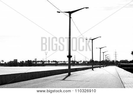 Black And White High Contrast Style Saterfront With Lanterns By The River