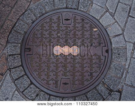 Manhole drain cover on the street at Shibuya, Tokyo, Japan.