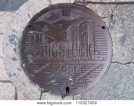 Manhole drain cover on the street at Kobe, Japan.