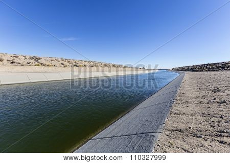 Aqueduct moving water through the Mojave desert in Southern California.