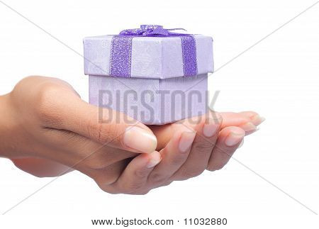 hand and gift box over white background
