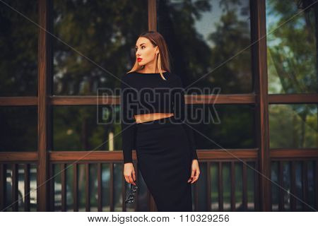 Fashionable Young Woman In Skirt