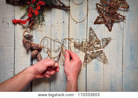 Man's Hands Do Fancy Work With Christmas Tree Decorations